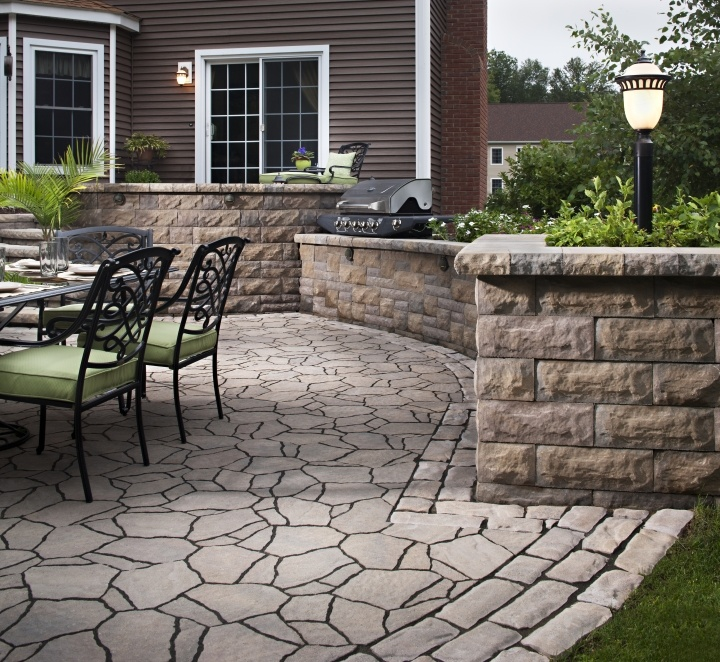 Mix and match pavers for an uncommon look that draws the eye from one surface to the next. This outdoor kitchen features Belgard Mega Arbel patio with Old World trim and Bel Air walls.
