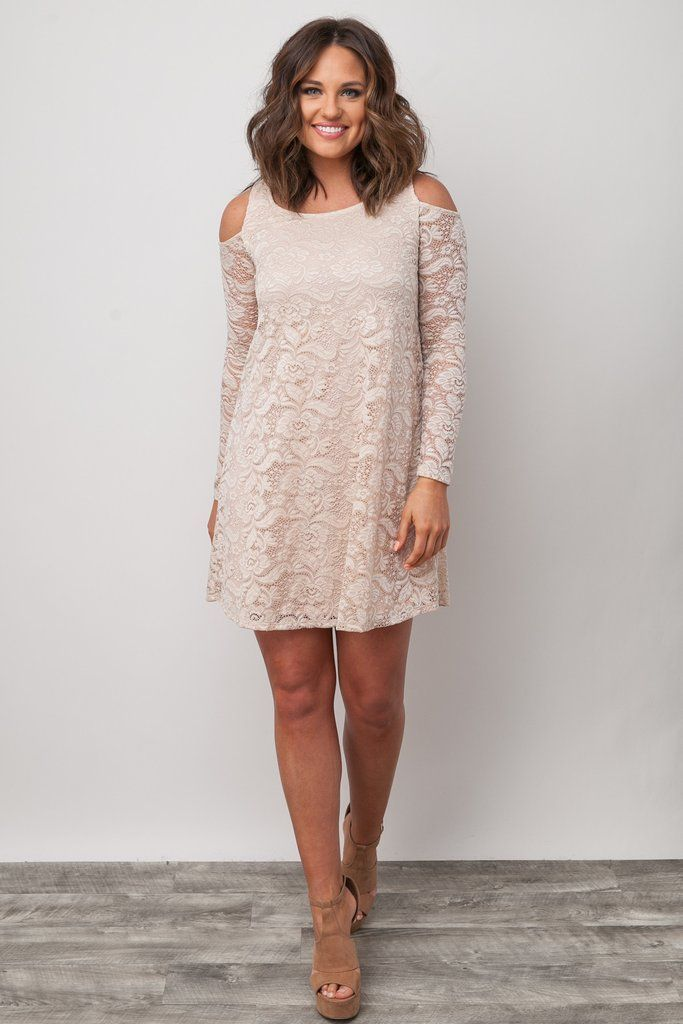 Good luck saying no to this cute little number! This cream lace dress features long sleeves, a lace overlay, and offers a flowier fit. The dress has a high crew neckline, cold shoulder detailing, and