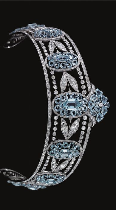 BELLE EPOQUE AQUAMARINE AND DIAMOND TIARA, CIRCA 1910 Designed as a series of graduated oval aquamarine clusters set with oval- and hexagonal-shaped aquamarines, interspersed with sprays of diamond myrtle leaves, within millegrain borders of circular-, single- and rose-cut diamonds, inner circumference approximately 370mm, fitted red leather and gilt tooled case.