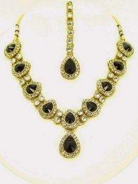 Gold Plated Kundan Necklace Set Adorned With Black Color