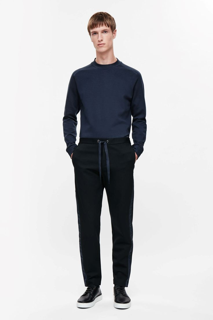 COS image 1 of Drawstring trousers with grosgrain details in Black