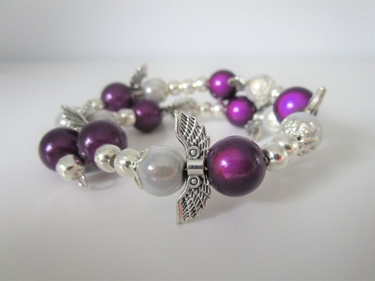 """Angels dancing around Memory Wire and make a lovely bracelet for Christmas time. Tibetan silver wings, silver plated parts, and miracle beads. - Can be made in other colours or """"round"""" instead of memory wire.  This bracelet is posted in my internet shophttps://angelsandelfs.com/"""