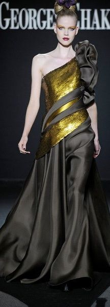 the idea of the symmetrical asymmetrical lines of top and skirt, emphasized by upward sashes in this Georges Chakra gown