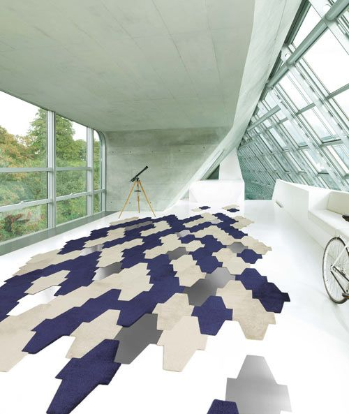 Scale Living is a collection of free-form carpet tiles from the German company Vorwerk Carpet and designer Hadi Teherani.