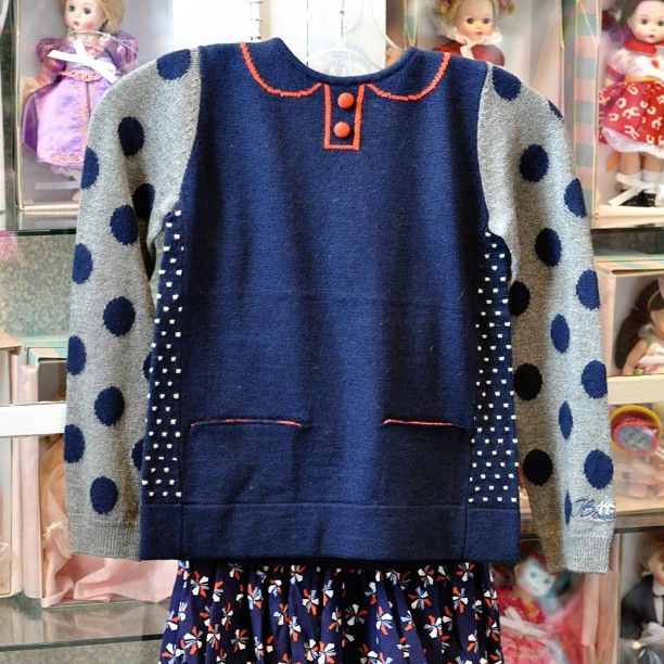 Jean Bourget trompe l'oeil girls sweater with little hand pockets and darling polka-dot sleeves. Shown paired with navy floral skirt. Back of sweater features orange colorblock at neckline. Dress it up or pair the top with jeans... It's an all-star! Sold at The Children's Hour in Salt Lake City.  898 South 900 East.  801.359.4150.  #thechildrenshour
