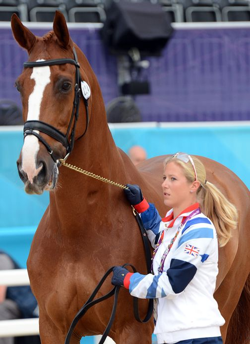 Laura Bechtolsheimer and Mistral Hojris (Great Britain) I'm not into the olympics at all, but this is a GORGEOUS horse.
