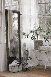 vintage mirror, old windows, sheer curtains ........ lovely.