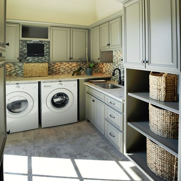 Love the backsplash and the cabinet color.  The only thing really missing here are pedestals for the washer/dryer