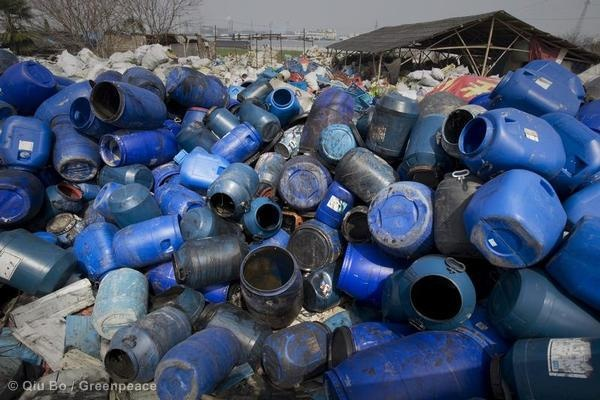 Barrels of dye sit in the industrial zone. © Qiu Bo / Greenpeace