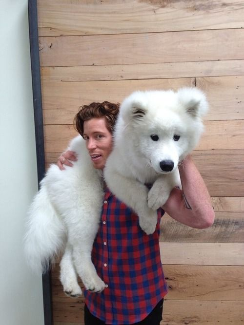 Shaun White wearing fur. That puppy is almost as adorable as shaun. ok the dog is way more adorable haha