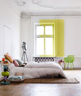 I love the splash of colour used in a room full of white. It is very bold