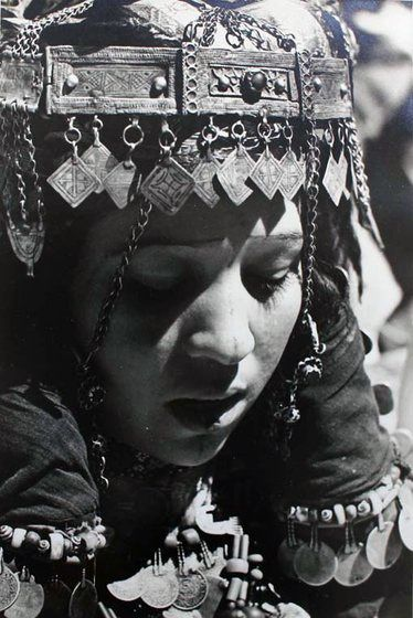 "Africa | Moroccan woman in the Draa Valley | From the publication ""Images du Maroc Berbere"" by Henri Duquaire, with photos by J. Belin. 1947"