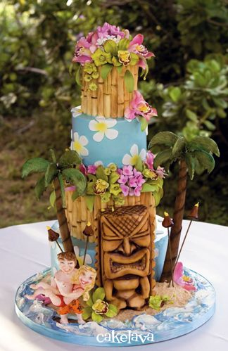 Hawaiian wedding cake with tiki and accents, palm trees, handcrafted flowers and custom figurines. Made by Rick Reichart. www.cakelava.com