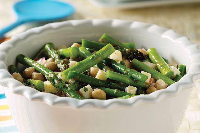 Enjoy great flavor with this Asparagus and Garbanzo Bean Salad. Add Monterey Jack cheese and Italian dressing to this Asparagus and Garbanzo Bean Salad.