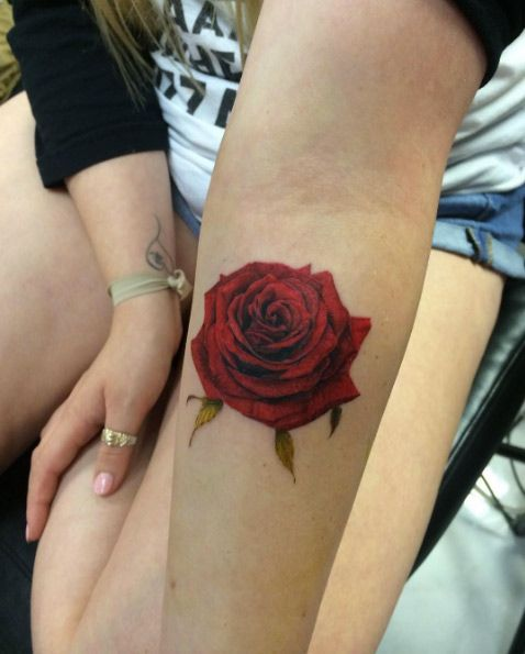 Red rose on forearm by Wonjun Jang