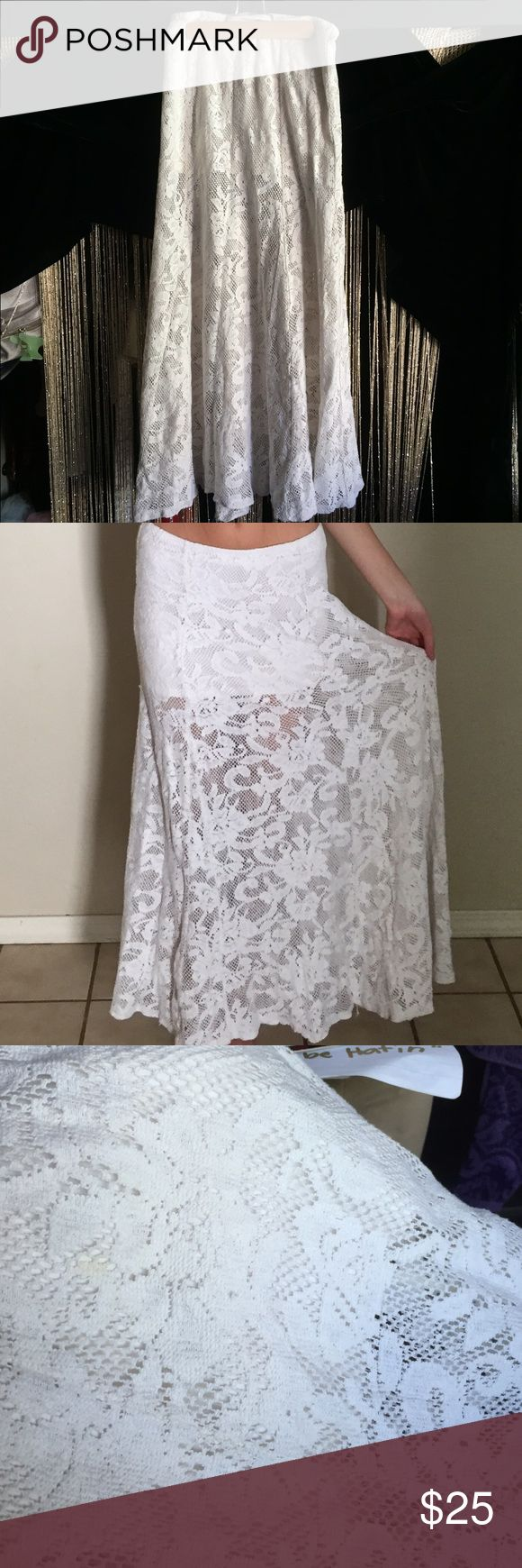 Lace maxi skirt Billabong white net see through skirt over a white mini skirt. It has one small stain that's shown in the 3rd picture that can be easily bleached out Billabong Skirts Maxi