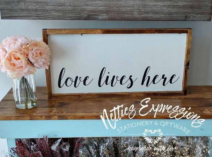 Love lives here 12.5x25.5 Framed Wood Sign - Netties Expressions
