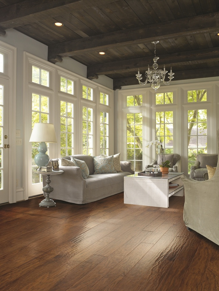 Fresh white trim and pale blue hues add a lightness to this space which is especially important with a dark, rustic floor and ceiling. http://www.beautifuldesignmadesimple.com