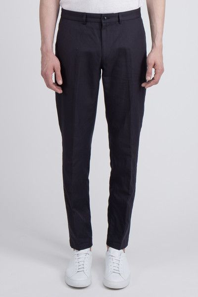 -The Badlands regular trouser has a straight, slightly tapered fit. Details include zip fly and two back pockets with buttons. This is our most classic trouser