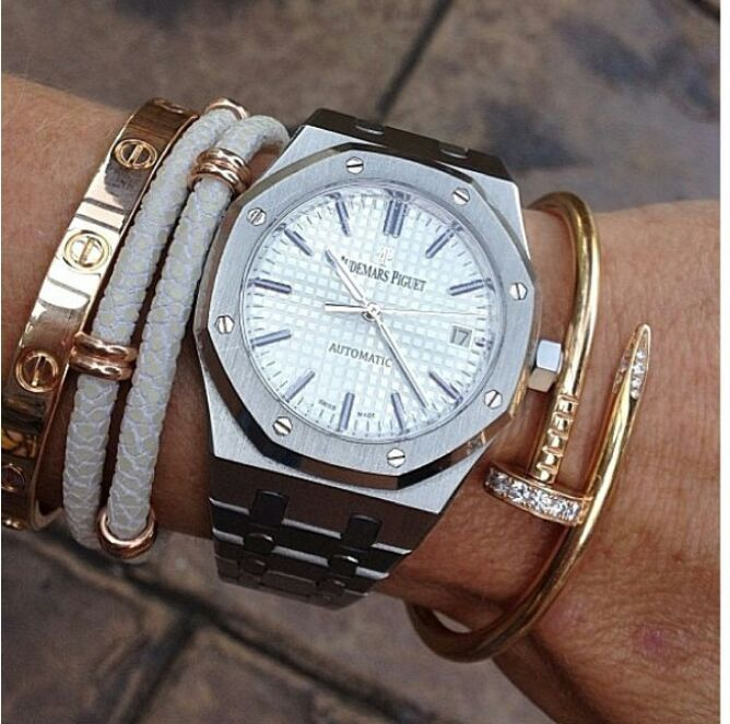 Audemars Piguet and Cartier love bracelet, want.