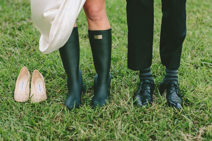 Wedding shoes Jimmy Choo's & Hunter Boots. Image: Cavanagh Photography http://cavanaghphotography.com.au