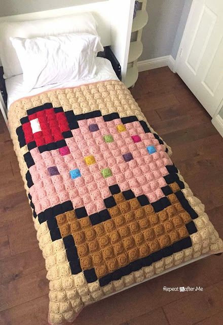 Don't be intimidated by pixel crochet! Repeat Crafter Me has a great walk through of her cupcake blanket, made with Vanna's Choice!