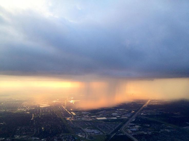 check this http://earth66.com/aerial/cousin-airplane-pilot-took-picture-rainstorm-air/