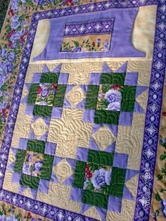 Beautiful lap quilt for wheelchair or other chairs with pockets to keep your hands warm.  Pockets are lined in flannel. $75.00 http://www.homesewnbycarolyn.com
