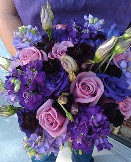 Purple lisianthus & stock with lavender roses.