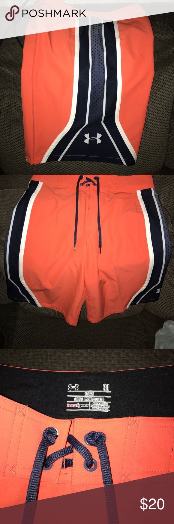 Excellent condition! men's board shorts🏊🏼 Under Armour men's loose fit board shorts🏄🏼.  Size 30 waist.  Velcro ties waist.  Excellent condition only worn once or twice.  Orange with black and white stripes. Under Armour Swim Board Shorts