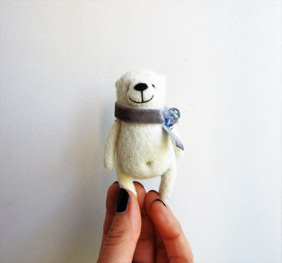 Needle felted White Bear brooch / gift for friend, in the gift box / hand made Bear / eco friendly / Miniature animal toy / Christmas gift This cute Bear is completely needle felted from a 100% real wool for the best result. It will be beautiful gift for you or your family, friends, colleague. This beautiful brooch is perfect for your jacket,bag or a hat. It has attached pin on the back. Size : about 7 cm (2,7 Inch) long. ********************************************** This brooch is MADE…