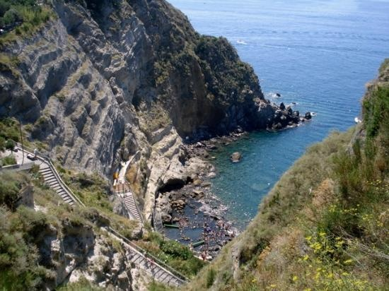 Baia di Sorgeto, Isola di Ischia: Beautiful bay for swimming and snorkeling as well as immersing in the thermal pools. Have a wonderful day sitting in the pools, enjoying the sea, and having a fabulous lunch. There is a small dock over the rocks for the taxi boat to Sant'Angelo.