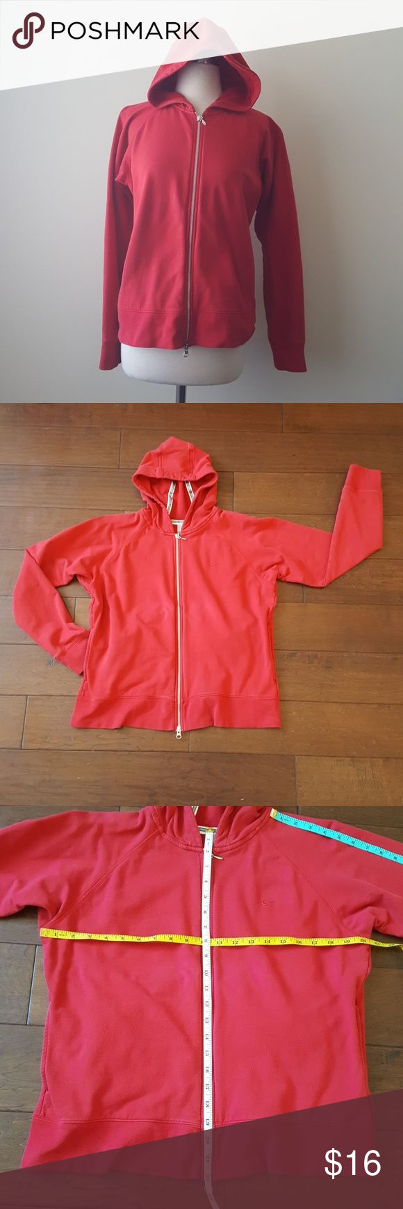 Nike Red Zip Up Hoodie Red Nike Hoodie Sweater.  95% cotton 5%Spandex. Has grey and white stripes along the inside of hoodie.  2 front pockets and Nike logo. Has light pilling and is a little bit faded from love and being washed. Nike Sweaters