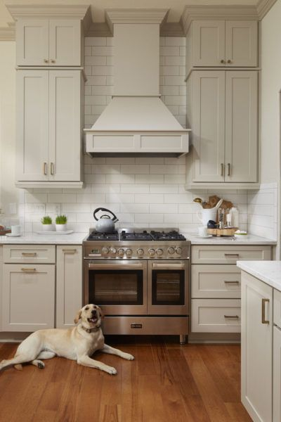 Transitional Gray Kitchen Makes For A Unique And Inviting Space With Images Wood Range Hood Outdoor Kitchen Countertops Kitchen Hoods