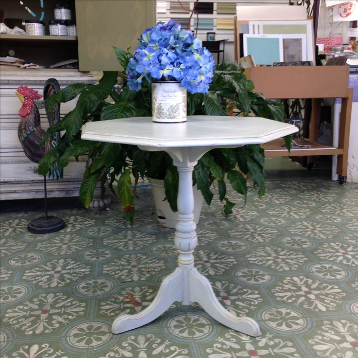 Small occasional table done in a Gustavian style.  The floor is also my work... Maison Blanche Vintage Paint used with an older stencil to create a Spanish tile look.