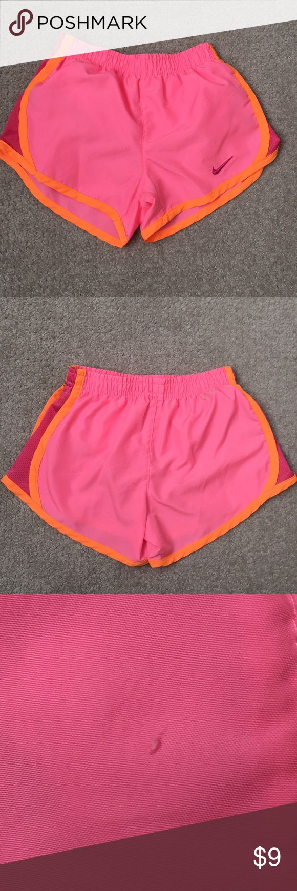 Girls Nike Dri-Fit shorts Girls Nike shorts in pink with orange piping. Super cute. In great condition. One blemish (tiny pull) on back near center seam (see pic 3) not noticeable. Worn a couple times. Has built in liner.  Girls size 5 Nike Bottoms Shorts
