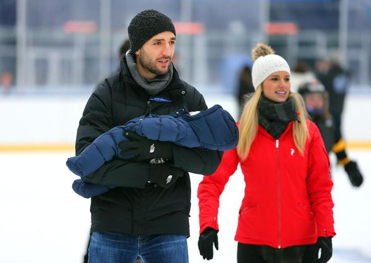 Foxborough12/30/15 Bruins Patrice Bergeron holds his son Zack, 10 weeks (born approximately 21 October 2015) as he skates with his wife Stephanie on the ice at Gillette Stadium. The Boston Bruins players and their families skated on the ice on the rink at Gillette Stadium as part of the festivities for the Winter Classic which will be played New Years Day against the Canadians. Boston Globe staff photo by John Tlumacki (sports)