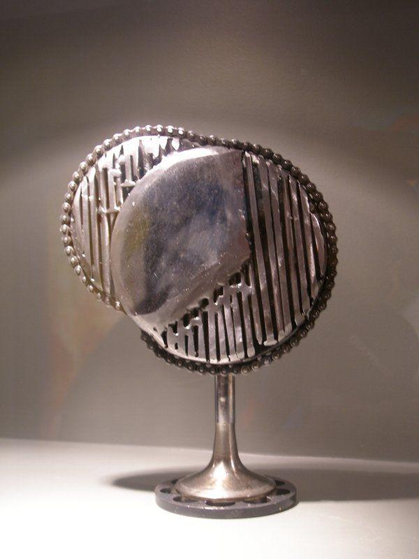 Circle metal sculpture handmade by Giannis Dendrinos