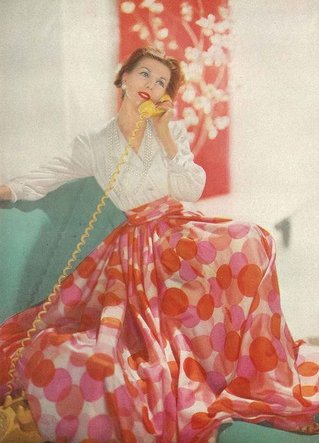 February Vogue 1957. Model is wearing a white silk crepe skirt with balloon dots in pinks and oranges and a white silk chiffon shirt, all made from a Vogue pattern.