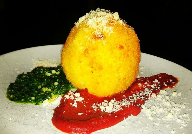 Arancini (served on tomato & pesto sauce).