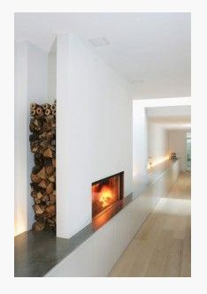 contemporary sheet rock fireplace surround with wood storage behind - built in flush bench