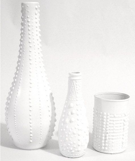 Recycle used bottles and cans by making them look like porcelain vases. - Texture from puffy paint then spray painted