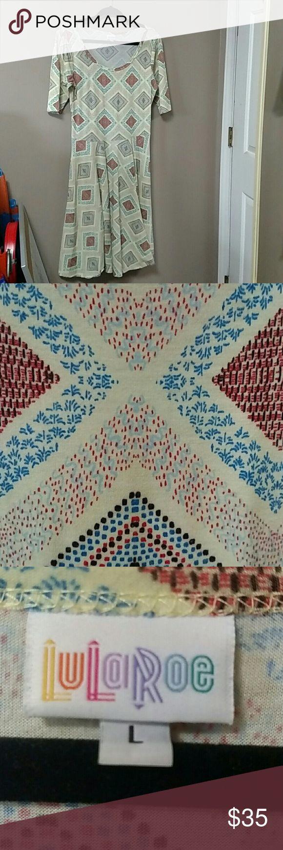 Lularoe Nicole pale yellow dress Lularoe Nicole pale yellow dress with salmon, blue and brown pattern. LuLaRoe Dresses Midi