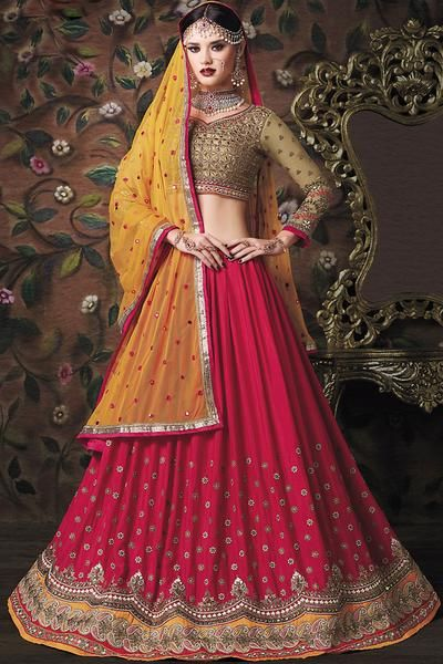 Lehengha is a form of indian subcontinent skirt which is long, embroidered and pleated. It is worn as the bottom portion of a gagra choli. It is secured at the waist and leaves the lower back and midriff bare. Enhance the wedding pageant by adorning this lehengha in beige and pink. This lehengha is designed with print, embroidery and lace border. The lehengha comes with banglori silk choli and skirt with and georgette dupatta.