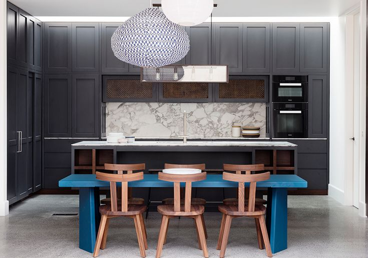 Grey theme kitchen with blue dining table & wood colour chair