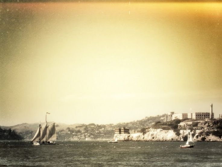 Old-fashioned boat sailing past Alcatraz Island in San Francisco ...