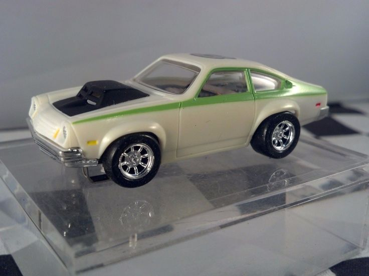 http://www.ebay.com/itm/Chevrolet-Vega-Pro-Stock-T-JET-White-Green-3-HO-SLOT-CAR-CUSTOM-WHEELS-/362069066615?hash=item544cff8377:g:7mEAAOSwP0ZZj5Jm
