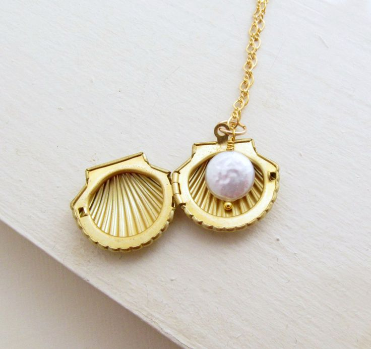 Sea Shell Locket Necklace Clam Shell Necklace Gold Shell Necklace Ocean Jewelry Pearl Necklace Gold Filled Chain Summer Wedding - Seashell. $44.00, via Etsy.