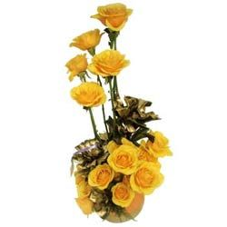 Bring a warming smile on the face of your loved ones with this golden creation from Ferns N Petals. This amazing arrangement of 15 fresh yellow flowers in a cane basket is certainly going to steal their heart . Present this brilliant piece of work to your loved ones, now. FNP.Com