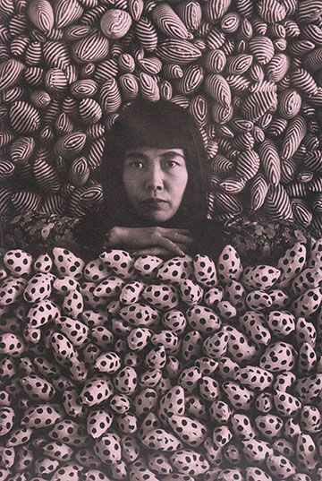 "y a y o i k u s a m a A R T I S T posing in her installation International Galerij Orez, 1965 ""Just weeks after moving into an East 19th street loft in September 1961, Yayoi Kusama, aided by Donald Judd, began sewing and stuffing hundreds of small canvas sacks full of cotton… Some were erect; others were semi-flaccid… this collision between what were now unmistakably phallic objects into this realm of kitsch-infused, quotidian femininity… undertaken to conquer her fear"